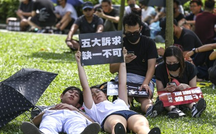 Protesters sneak a nap during a rally to support striking students at Tamar Park on Tuesday. Photo: Tory Ho