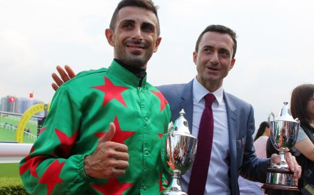 Jockey Alberto Sanna and trainer Douglas Whyte celebrate Big Fortune's win. Photos: Kenneth Chan
