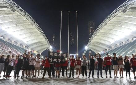 Football fans protest as they attend the Hong Kong vs Iran World Cup qualifying match at Hong Kong Stadium. Photo: Felix Wong