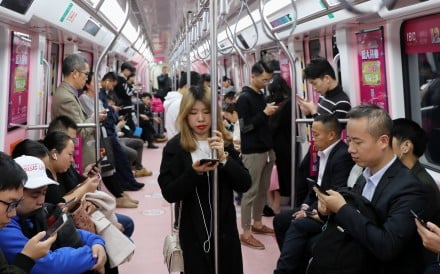 A woman is surrounded by men in a priority carriage on the Shenzhen metro. Photo: Sam Tsang