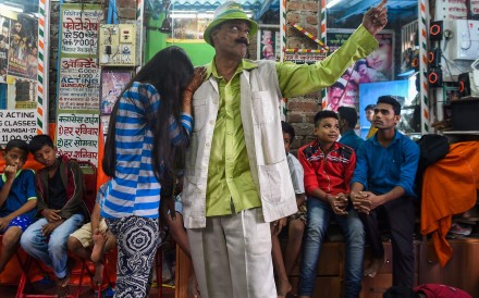 Acting teacher Baburao Ladsaheb performs for his students during a class at the 'Five Star Acting Dancing Fighting Classes' in Dharavi, Mumbai, one of India and Asia's biggest slums. Photo: AFP