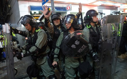 "Riot police retreat after clashes with protesters on Sunday. A Save the Children spokeswoman said the decision to cancel the event was made ""in light of the recent protests in Hong Kong"". Photo: EPA-EFE"