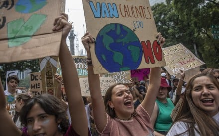 Protesters hold signs during a global climate strike demonstration in Mexico City on Friday. Photo: Bloomberg