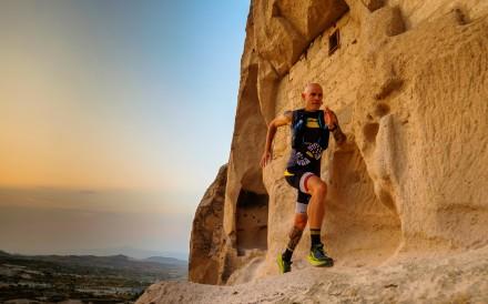 Gediminas Grinius running past houses cut into rock chimneys on the beautiful Cappadocia Ultra Trail. Photos: Steve Thomas