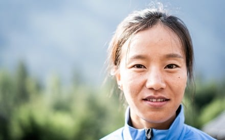 Lu Yangchun grew up in a remote mountain village, and has worked her way up to being a professional runner through the state sports school system. Photo: Ian Corless/Adidas Terrex/UTMB