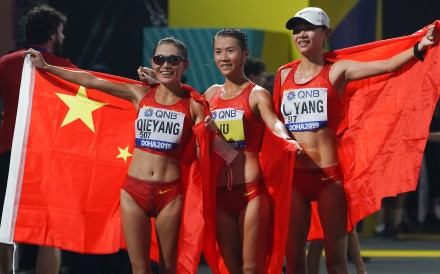 China dominated the women's 20km race walk with Liu Hong (centre) taking her third world title in Doha. Photo: Xinhua