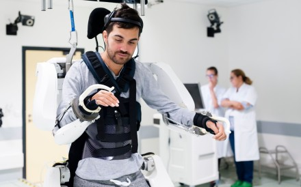 French quadriplegic Thibault stands while wearing an exoskeleton at Clinatec laboratory at the University of Grenoble. Photo: AFP