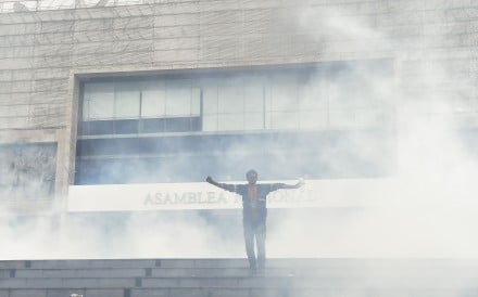 Anti-government protesters briefly stormed the Ecuadorean parliament in Quito before being driven out by police. Photo: AFP