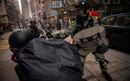 Hong Kong police and protesters clash on October 1. Photo: AFP