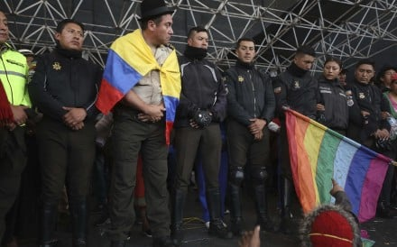 Police detained by anti-governments protesters are presented on a stage in Quito. Photo: AP