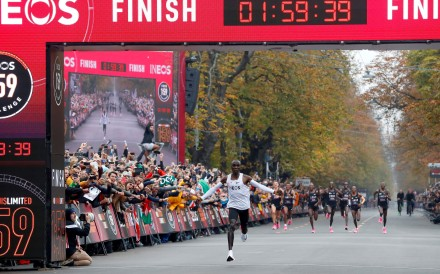 Kenya's Eliud Kipchoge, the marathon world record holder, crosses the finish line during his successful attempt to run a marathon in under two hours in Vienna. Photo: Reuters