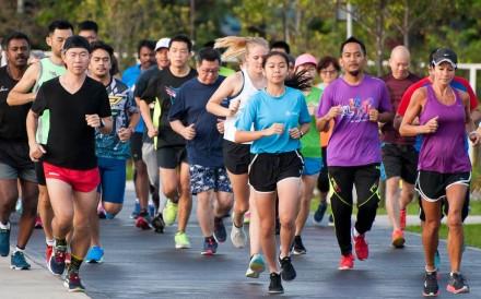 Runners taking part in the Taman Pudu Ulu Parkrun in Kuala Lumpur, Malaysia. The 5km running event has become a global phenomenon. Photo: Parkrun