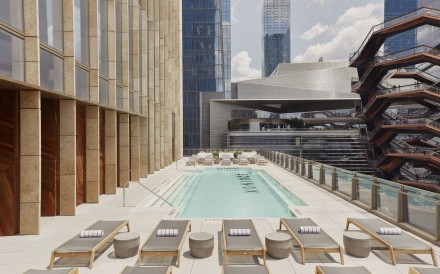 The outdoor 'leisure pool' at New York City's Equinox Hotel offers skyline views of Manhattan.