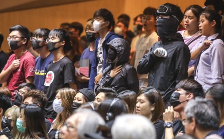 Chinese University students and alumni, some in protesters' gear, at an earlier dialogue session with vice-chancellor Rocky Tuan. Photo: K.Y. Cheng