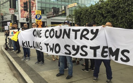 """Hongkongers protesting outside the Hong Kong Trade Development Council symposium in Los Angeles, US, on September 21. """"One country, two systems"""" does not have to die come 2047. Photo: Tony Cheung"""