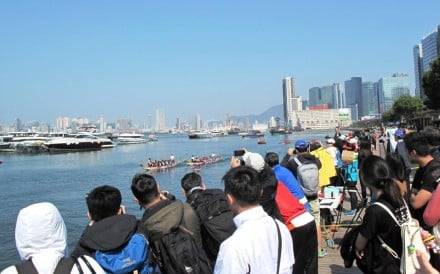 Fans turn out to watch a test event in 2016 at the proposed water sports centre in Kai Tak. Photo: HKWSC