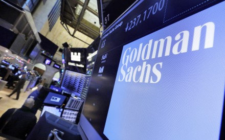 The logo for Goldman Sachs appears above a trading post on the floor of the New York Stock Exchange. Photo: AP