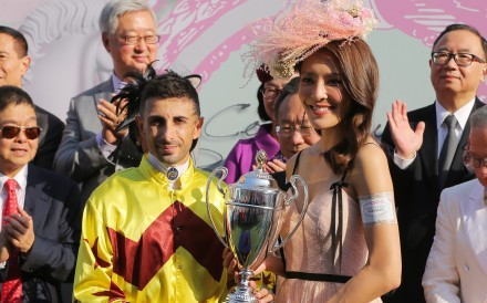 Kelly Cheung presents the trophy to winning jockey Alberto Sanna. Photos: Kenneth Chan