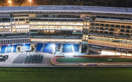 Happy Valley racecourse is deserted after a race meeting was cancelled. Photo: Martin Chan
