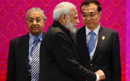 India's Prime Minister Narendra Modi walks past Malaysia's Prime Minister Mahathir Mohamad (left) and China's Premier Li Keqiang (right) during the 14th East Asia Summit in Bangkok on November 4, on the sidelines of the 35th Asean Summit. Photo: AFP