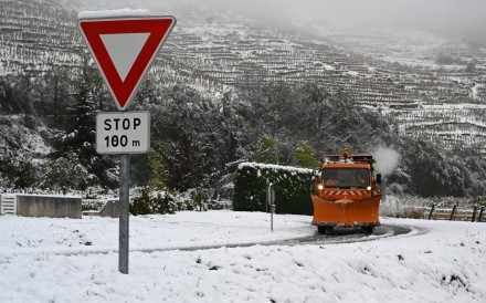 A snowplough drives along a snow-covered road near Tournon-sur-Rhone on Friday. Photo: AFP