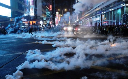 Tear gas fired during clashes between anti-government protesters and anti-riot police at the junction of Nathan Road and Argyle Street in Mong Kok on October 27. Photo: Sam Tsang