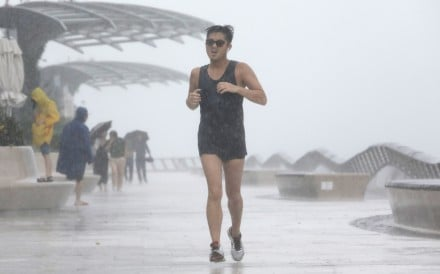 A runner in the rain may be happy, but a good windproof or waterproof jacket can make all the difference. Photo: May Tse