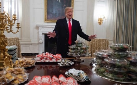 US President Donald Trump speaks alongside fast food he bought for a ceremony honouring the 2018 College Football Playoff National Champion Clemson Tigers at the White House. File photo: AFP