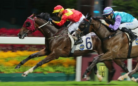 Silvestre de Sousa drives Above to victory at Happy Valley on Wednesday night. Photos: Kenneth Chan