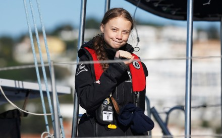 Greta Thunberg arrives aboard the yacht La Vagabonde at Santo Amaro port in Lisbon, Portugal, on her way to the UN Climate Change Conference. Photo: Reuters