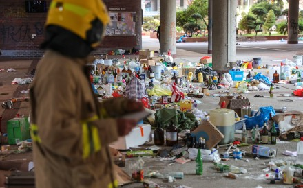 A firefighter examines flammable items at Polytechnic University in Hung Hom on November 28. The campus had been taken over by protesters for 13 days. Photo: Sam Tsang