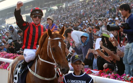 Zac Purton celebrates after winning the 2017 Hong Kong Cup with Time Warp. Photos: Kenneth Chan