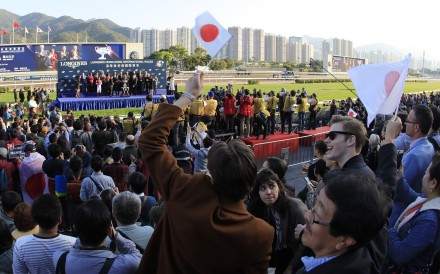 Racing fans wave Japanese flags after Win Bright's victory in the Hong Kong Cup. Photos: Kenneth Chan