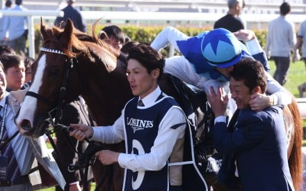 Christophe Soumillon gives trainer Yasuo Tomomichi a kiss after Admire Mars' win in the Hong Kong Mile. Photos: Kenneth Chan