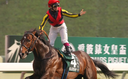 Umberto Rispoli wins the QE II Cup (2,000m) on Rulership in 2012. Photos: Kenneth Chan