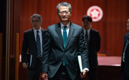Financial secretary Paul Chan leaves the Legislative Council after delivering his budget speech on February 27. Since then, Chan has announced a series of measures to help businesses and sections of the society hard hit by six months of protests and the US-China trade war. Photo: Bloomberg