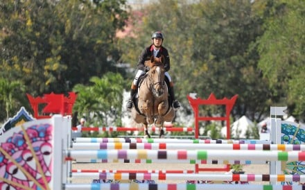 Kenneth Cheng competes aboard his horse Tyson AZ. Photos: HKJC
