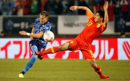 China's Jin Jingdao and Japan's Yosuke Ideguchi in action at the 2019 EAFF E-1 Football Championship in Busan, South Korea. Photo: Reuters