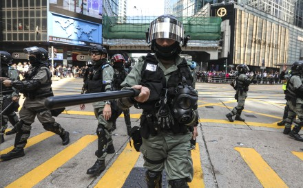 Riot police in action during a lunchtime rally in Central on November 20. Photo: Xiaomei Chen