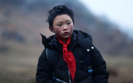 Nine-year-old Wang Fuman's family has now moved from their mud hut to a two-storey home. Photo: AFP