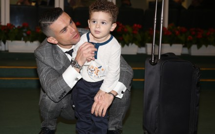 Umberto Rispoli with his son Hayden after his final ride in Hong Kong on Sunday. Photos: Kenneth Chan