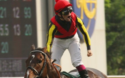 Umberto Rispoli celebrates after winning the Group One QE II Cup in 2012. Photos: Kenneth Chan