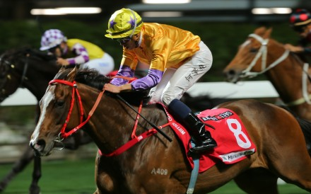 Vincent Ho guides Doctor Geoff to victory in the Group Three January Cup at Happy Valley on Wednesday night. Photos: Kenneth Chan
