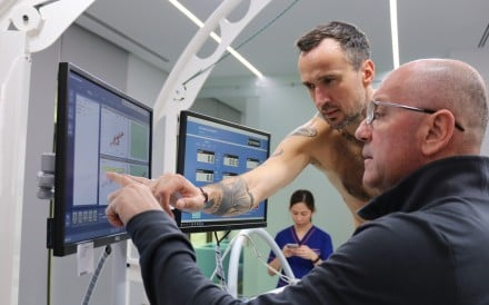 Patrick Blennerhassett going over his VO2 max test results with Dr Dejan Jovanovic from Emirates SportsMed. Photo: Emirates SportsMed