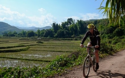 Riding a bike through northern Laos is a great way to explore tribal villages and beautiful scenery. Photo: Steve Thomas