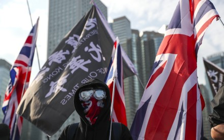 Protesters stand amid British flags during a demonstration calling for sanctions on the Hong Kong government, in Central on January 12. Photo: Sam Tsang