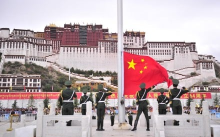 Soldiers attend the flag-raising ceremony in front of the Potala Palace in Lhasa, capital of southwest China's Tibet Autonomous Region. Photo: Xinhua