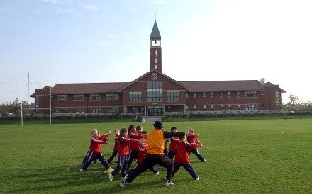 Pupils on the sports field at the Pudong campus of the Dulwich College in Shanghai on 30 December 2004. Photo: Handout.