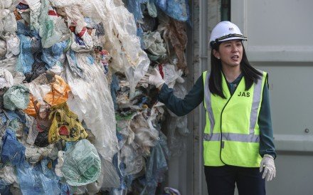 Malaysia's environment minister Yeo Bee Yin stands beside a container full of plastic waste just before it is shipped back to its country of origin. Photo: EPA-EFE