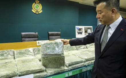 Superintendent Barry Chu with some of the cannabis uncovered in the seizure. Photo: Dickson Lee